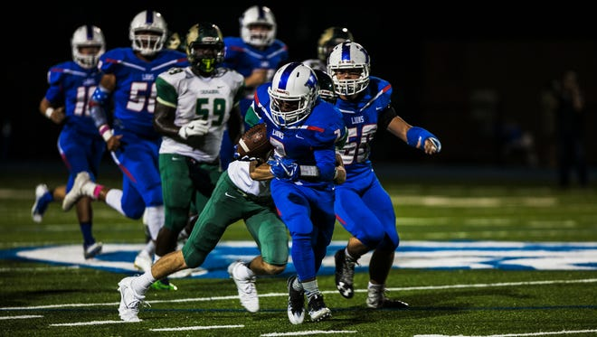 October 5, 2017 - Harding Academy running back Tyler Moore (2) gains yardage against First Assembly Christian School during the first quarter at Harding on Thursday.