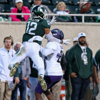 MSU's R.J. Shelton leaps over a Northwestern defender