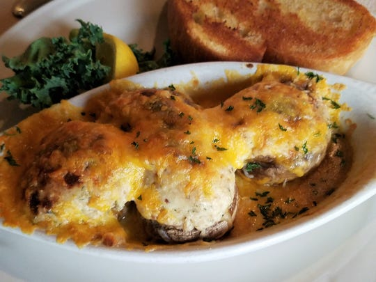 The stuffed mushrooms at Haub House are a classic, with cream cheese, a touch of crab, and a cheesy broiled topping, served with garlic bread to soak up all the juices.