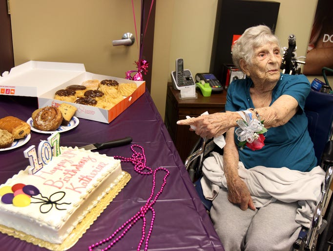 Katherine Estelle Woodruff of Manalapan, who turns 107 years old on Wednesday, points to the candles on her birthday cake during a birthday celebration thrown by the staff of Taylors Mills Medical before her doctor's appointment with Dr. Alexander Goldberg at the family medical center in Manalapan, NJ Tuesday August 26, 2014.  Staff photo Tanya Breen