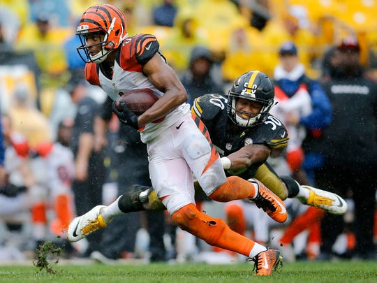 Cincinnati Bengals wide receiver James Wright (86) fights off a tackle from Pittsburgh Steelers inside linebacker Ryan Shazier (50) on a reception in the fourth quarter of the NFL Week 2 game between the Pittsburgh Steelers and the Cincinnati Bengals at Heinz Field in Pittsburgh on Sunday, Sept. 18, 2016. The Bengals fell to 1-1 with a 24-16 loss to the Steelers.