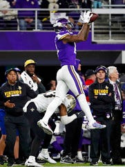 Minnesota Vikings wide receiver Stefon Diggs (14) makes a catch over New Orleans Saints free safety Marcus Williams (43) on his way to the game-winning touchdown in the final seconds of the game Jan. 14.