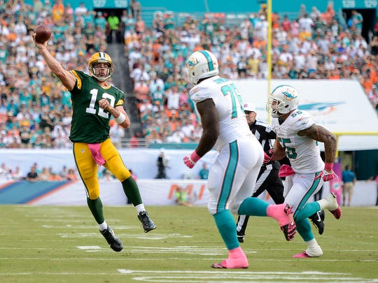 Green Bay Packers quarterback Aaron Rodgers makes a pass to receiver Randall Cobb for a touchdown against the Miami Dolphins in the third quarter during the Oct. 12, 2014, game at Sun Life Stadium in Miami, FL. USA Today Network-Wisconsin