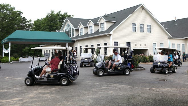 File: Golfers drive out to their tees for the shotgun start of the Edgarton Christian Academy golf tournament at Running Deer Golf Club in Pittsgrove Township.