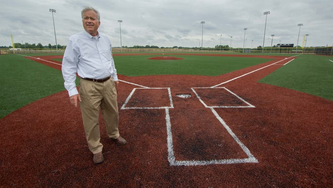 Westfield Mayor Andy Cook stands near home plate on the championship baseball field at Grand Park on June 10, 2014. The 400-acre sports park officially opens with a ribbon cutting June 21.