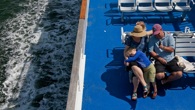 Ellen and Tad Hewit of Glen Rock, Bergen County, enjoy the ride on a Cape May-Lewes ferry with their children Britton, 5, and Caroline, 2, last week.