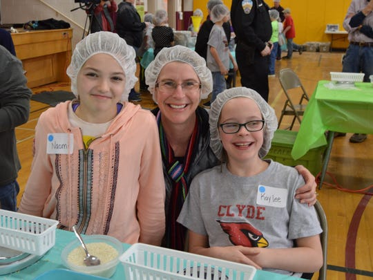 Naomi Roberts along with Kristine Shallenberger and Kaylee Shallenberger helped package meals at Clyde Elementary School.