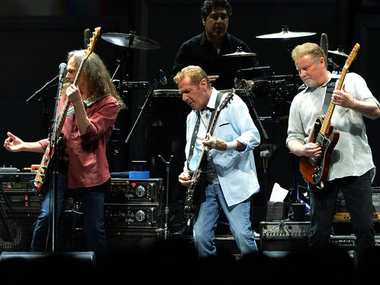 Timothy B. Schmit, Glen Frey and Don Henley of the Eagles perform Oct. 16 in Nashville, Tenn. The Eagles draw mixed reviews from music aficionados.