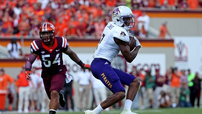 Sep 24, 2016; Blacksburg, VA, USA;  East Carolina Pirates wide receiver Zay Jones (7) catches a pass against Virginia Tech Hokies linebacker Andrew Motuapuaka (54) during the second quarter at Lane Stadium.