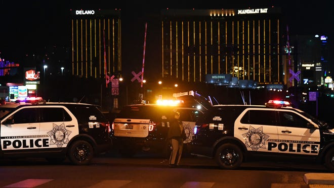 Police form a perimeter around the road leading to the Mandalay Bay hotel after a gunman opened fire on a country-music festival in Las Vegas on Oct. 1, 2017.