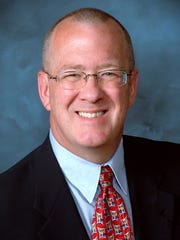 Michael Hicks is director and associate professor of