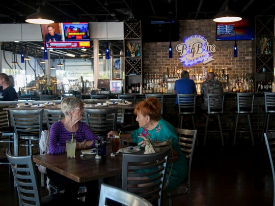 Guests eat lunch in Big Blue Brewing's spacious dining room. The menu features burgers, flatbreads, salads and sandwiches using local ingredients and made from scratch.