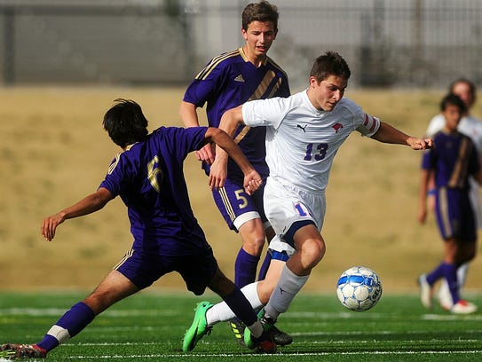 Cooper High's Luke Lopez (13) is tripped up by Midland's