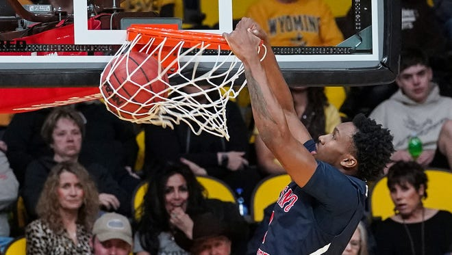 Fresno State's Jaron Hopkins dunks Saturday during the Bulldogs' win over Wyoming in Laramie. By winning where Mountain West front-runners Nevada and Boise State could not, Fresno State made a big jump this week in our MW power rankings.