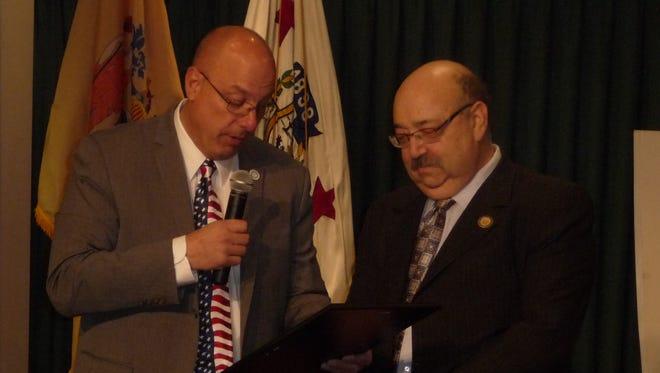 Hawthorne Council President John Bertollo presents a proclamation to Mayor Richard S. Goldberg for 20 years of service.