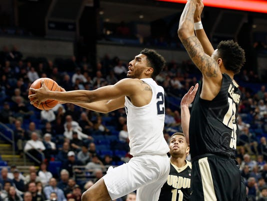 Penn State's Josh Reaves (23) drives to the basket as Purdue's Vincent Edwards (12) defends during the first half of an NCAA college basketball game in State College, Pa., Tuesday, Feb. 21, 2017. (AP Photo/Chris Knight)