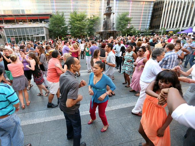 Hundreds of people dance to the sounds of Orquesta Kandela.
