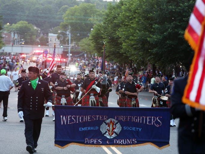 Firefighters from around the region take part in the annual Mamaroneck fire department parade in the village of Mamaroneck July 1, 2014.