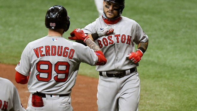Boston's Michael Chavis, right, celebrates with teammate Alex Verdugo after hitting a two-run home run in the sixth inning against the Tampa Bay Rays at Tropicana Field on Wednesday night.