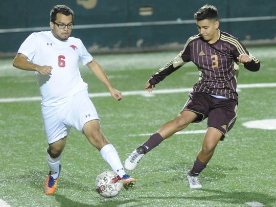 Cooper's Crespin Garza (6) battles Brownwood's Sabastian Rodriguez (8) for the ball. The Cougars beat Brownwood 4-1 in the nondistrict soccer game Friday, Jan. 26, 2018 at Shotwell Stadium.