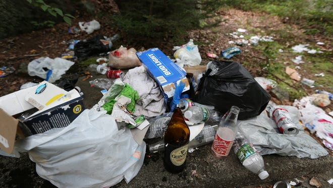 Mounds of garbage along a trail at Pine Meadow Lake in Harriman State Park Aug. 11, 2016.