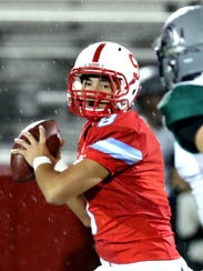 South Salem's Elijah Enomoto-Haole (8) looks to pass