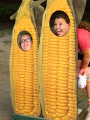 Lesux Stevenson and Jazzlyn Gardner pose as corn outside the Witter Agricultural Museum at last year's Great New York State Fair.