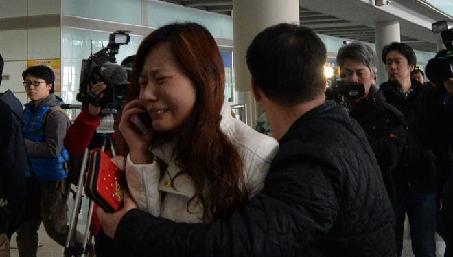 A woman cries at Beijing Airport on March 8 after hearing that a Beijing-bound Malaysia Airlines flight carrying 239 people went missing.