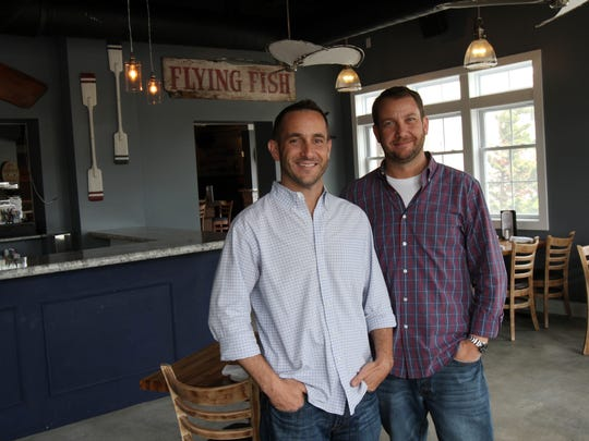Brothers Bob (left) and Chris Fahey opened Reef & Barrel earlier this year in Manasquan.