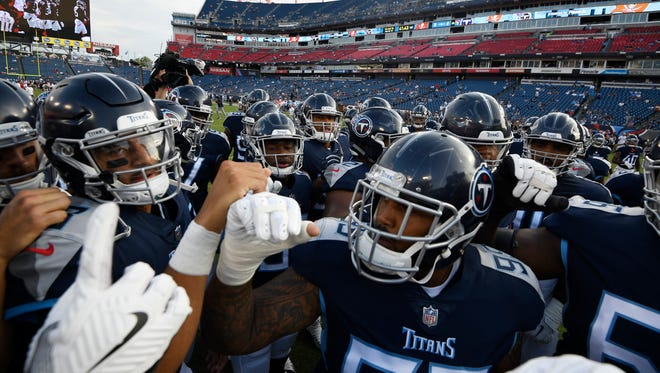 Titans quarterback Marcus Mariota (8) leads the team huddle before the start of the preseason game against the Tampa Bay Buccaneers on Saturday at Nissan Stadium.
