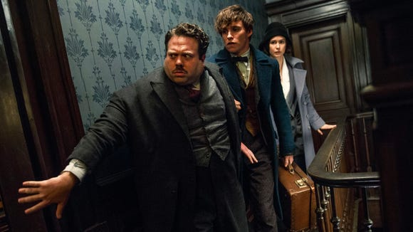 Dan Fogler, from left, Eddie Redmayne and Katherine