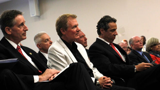Lt. Gov. Robert Duffy, Danny Wegman and Gov. Andrew Cuomo attend the unveiling of the Finger Lakes Regional Economic Development Council in July 2011.