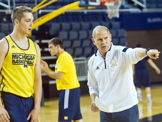 Michigan Wolverines coach John Beilein gives instructions to forward Mark Donnal during a practice session at Crisler Center on Oct. 2.