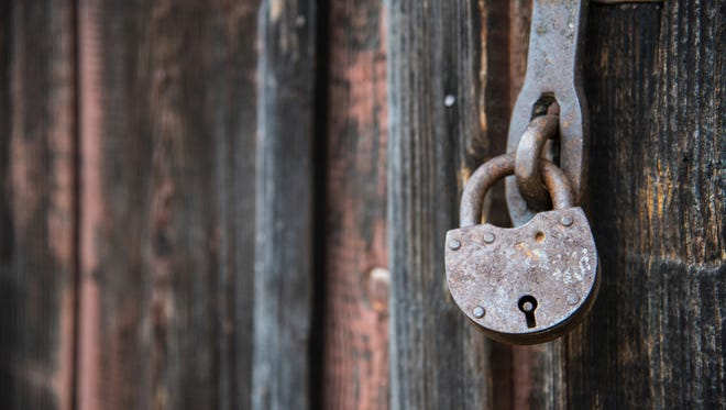 This padlock may not be in the creepy Louisville house Olivia Cole wrote about, but we imagine they would appear something like this.