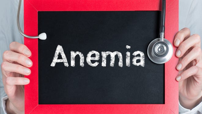 Doctor shows information on blackboard: anemia