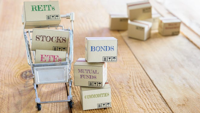 Cartons of financial investment products in a shopping cart i.e REITs, stocks, ETFs, bonds, mutual funds, commodities. A concept of portfolio management with risk diversification for optimal returns.