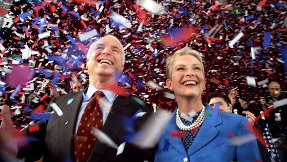 John McCain and his wife, Cindy, smile as confetti