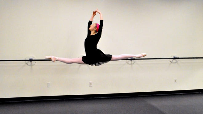 Grace Choi, a new member of the Cincinnati Ballet's corps de ballet, rehearses in a dance studio.