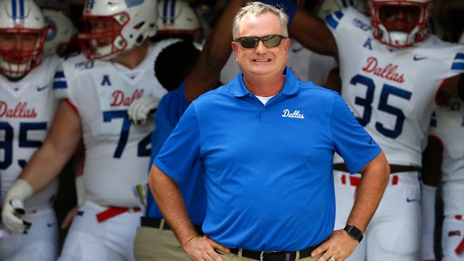 FILE - In this Sept. 21, 2019, file photo, SMU head coach Sonny Dykes waits with his team before playing TCU in an NCAA college football game, in Fort Worth, Texas.  Shane Buechele is the starting quarterback for an undefeated Top 25 team, like so many people envisioned when he started 12 games as a true freshman for Texas. Except Buechele is now close to home after going to No. 19 SMU as a graduate transfer. Dykes is in a similar situation, back home in Texas as a head coach. (AP Photo/Ron Jenkins, File)