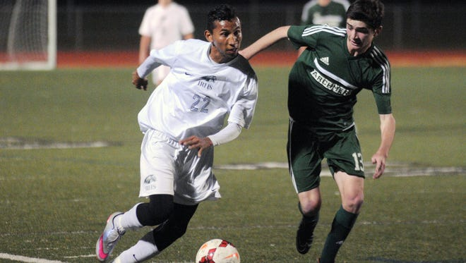 Indian River's Maykin Josue Nunez Gutierrez and Archmere's Matthew McCurnin run for the ball during the DIAA semifinal game at Appoquinimink High School.