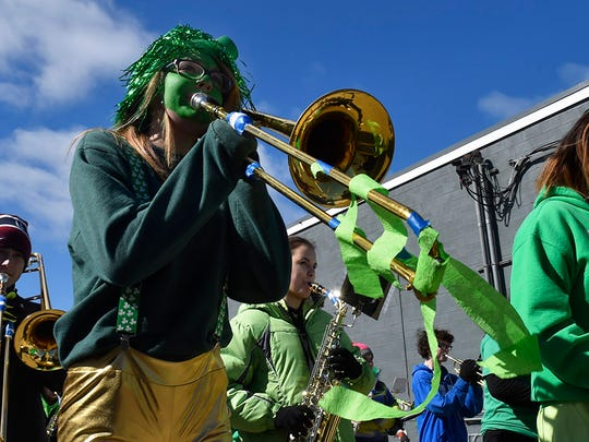Trombonist Leslie Kivell shares the Irish spirit during a previous parade.