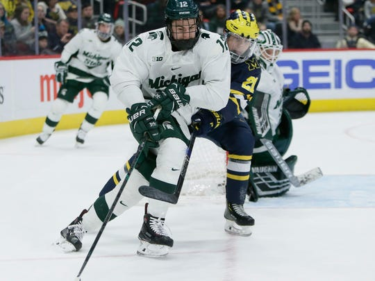 Michigan State defenseman Tommy Miller (12), shown last weekend against Michigan, scored a goal in the Spartans' 5-3 win over Penn State on Friday night. (AP Photo/Duane Burleson)