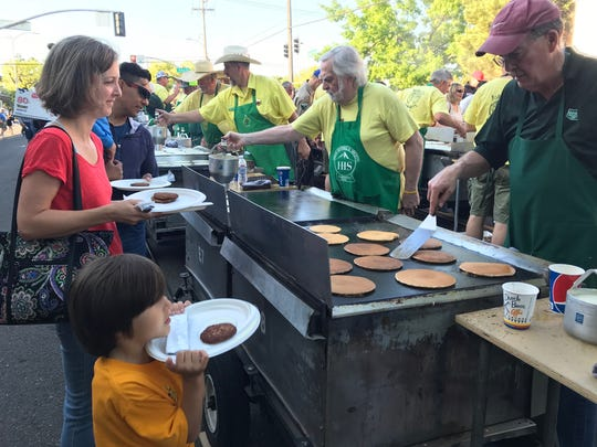 The lines were long, but the Asphalt Cowboys and their helpers worked quickly to keep up during Friday's pancake breakfast.