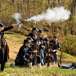 James T.R. Jones firs on Confederate soldiers during a 2011 Civil War re-enactment at Fort Duffield Park and Historic Site. The Fort Duffield Heritage Committee will hold a benefit auction at 7 p.m. Friday to raise money for additions to the fort.
