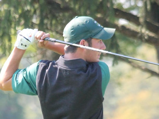 McNick senior Ty DeBonis watches his tee shot on No.