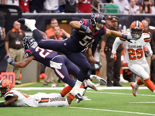 Houston Texans linebacker Dylan Cole (51) is upended