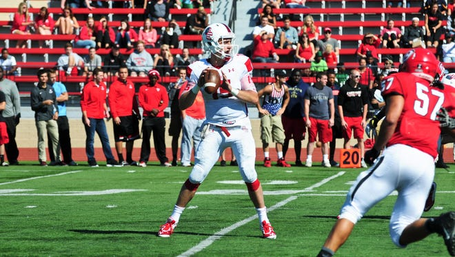 Olivet College quarterback Braden Black throws against Carthage College (Kenosha, Wisconsin) last season.