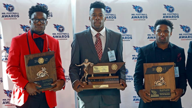 Raleigh Egypt's Kaylon Grandberry, center, stands with his Mr. Football trophy with finalists, Fairview's Darius James, left and Pearl Cohn's Jimmyrios Parker at Nissan Stadium, Monday, Nov. 27, 2017, in Nashville, Tenn.