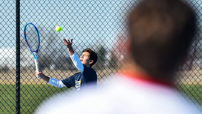 River Valley's Manny Acuna serves the ball during a tennis match last season against Pleasant. Acuna will vie for an MOAC boys tennis title Saturday.