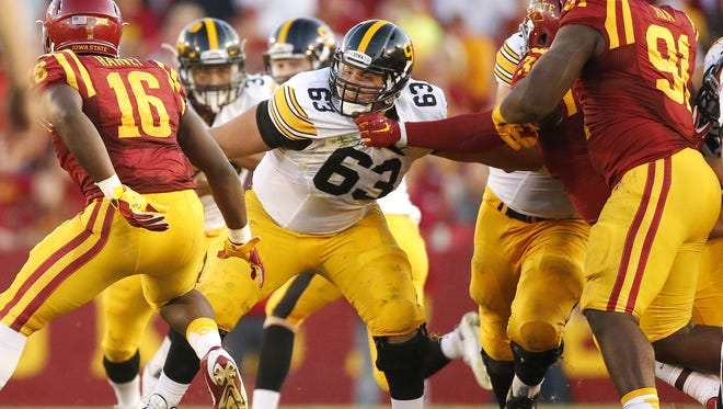 Iowa senior center Austin Blythe battles in the trenches in the Hawkeyes' 31-17 win over Iowa State on Sept. 12.